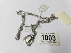 A silver full Albert chain, fancy link, dated Birmingham 1901 with shield shape fob. 33.8 grams.