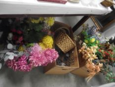 2 boxes of artificial flowers and a box of flower holders and wicker baskets etc.