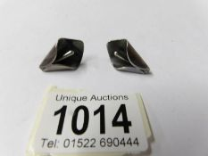 A pair of Birger Haglund (Swedish silver smith) silver earrings designed as tulips,