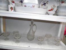 A good set of 6 vintage dessert dishes and a claret jug