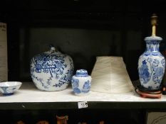 A mixed lot of blue and white including pumpkin jar and table lamp.