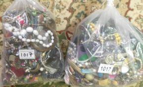 A quantity of costume jewellery in 2 bags, approximately 7 kg.