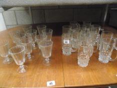 A dozen vintage 1/2 pint beer glasses and 10 wine glasses