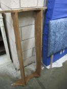 A set of pine wall mounted kitchen shelves