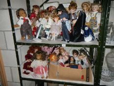 2 shelves of collector's dolls etc.