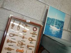 A framed rope knot collage and a picture.