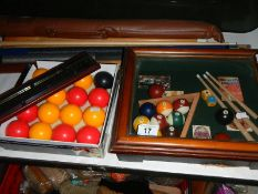 A billiards display cabinet, cues, balls and scoreboard.