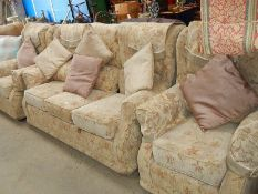 An oyster patterned three piece suite.