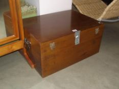 A modern varnished storage box with lockable clasp