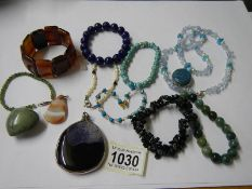 A mixed lot of stone pendant and bracelets, various coloured stones.