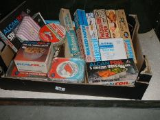 A mixed lot of vintage kitchenalia, foil food trays etc., all in original packaging.