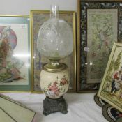 A Victorian pottery and brass oil lamp.