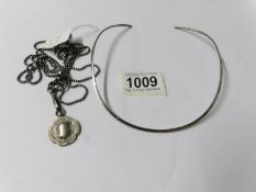 A silver collar necklace stamped T.