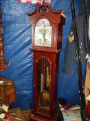 A 31 day modern 5ft long case clock.