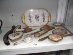 A quantity of vintage hair brushes, mirrors,
