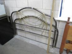 A chrome and brass coloured metal bed frame