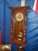 A Victorian Vienna style wall clock.