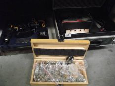 A Bosch cast with sander, box of wood drill bits, boxed drill with battery and empty case.