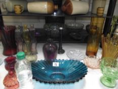 A selection of coloured glass, vases, bowls etc.