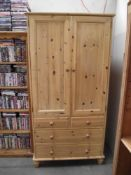 A pine double wardrobe with 3 drawers in base