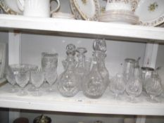 A collection of glassware including wine glasses, decanters, vases & bowls etc.