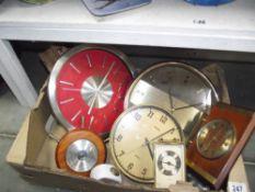 A box of various clocks/barometers