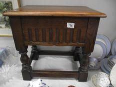 A darkwood table/sewing/storage box