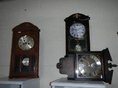 A quantity of wall clocks.