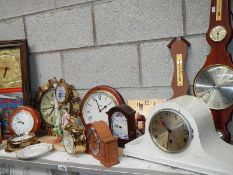 A large shelf of mantel clocks.