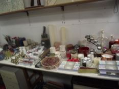 A large lot of candles, candle holders, candle snuffers, tealights etc.