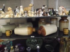 A quantity of stoneware flasks, jars and hot water bottles etc.