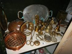 A shelf of brass and copper items.