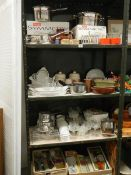4 shelves of kitchen ware including new saucepans.