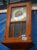 An oak wall clock.