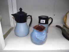A good teapot and matching jug and a piece of motto ware 'Sunshine makes shadows'