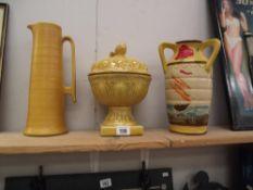 A tri-handled vase depicting sailing ships,