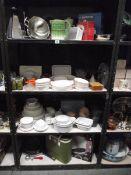 4 shelves of kitchen ware.