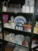 4 shelves of kitchen ware including some new items.