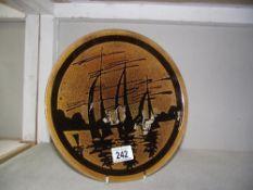 A Poole pottery plate yacht on sea