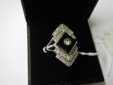 An 18ct onyx and diamond deco style ring in white gold, size N.