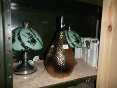 A pair of bedside lamps and one other.