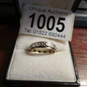 A white stone set eternity ring in 9ct gold, dated Birmingham 1973.
