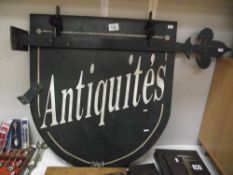 A double sided French metal shop sign 'Antiquities'