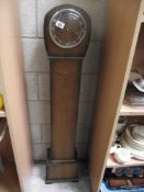 An Edwardian oak Grandmother clock