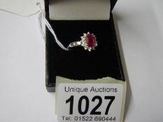 An 18ct gold ruby and diamond ring (Ruby 125, diamond 70pt), size M half.