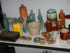 A mixed lot of old bottles, stoneware pots etc.