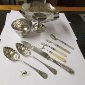 A small embossed silver bowl (67 grams), a silver plate comport,