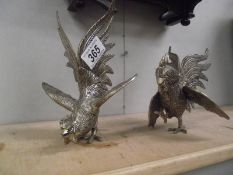 A pair of silver plate fighting cocks.