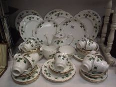 In excess of 50 pieces of Colclough tea and dinner ware including teapot.