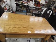 A light oak solid coffee table.